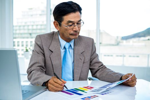 Businessman looking at graphics