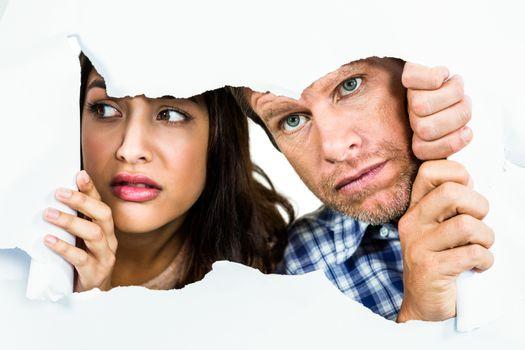 Fearful couple peeking
