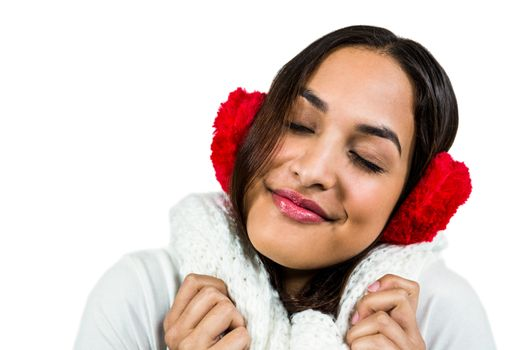 Close-up of woman wearing ear muff while eyes closed