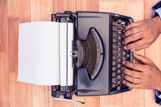 Businessman typing on typewriter