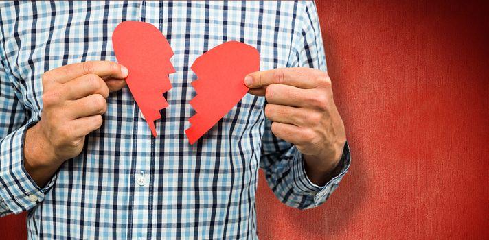 Composite image of sad man with broken heart