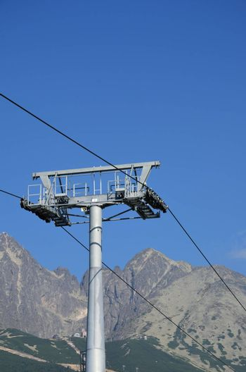 Cable car mechanism with mountains in background