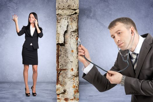 Businessman with stethoscope hearing grey wall with businesslady