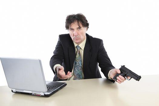 Portrait Of Businessman With Gun Over White Background