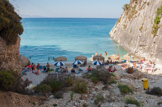 Zakynthos, Greece - August 27, 2015: Tourists on the Xigia beach with a sulfur and collagen spring on Zakynthos, Greece