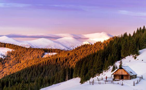 Mountain cabin at dawn