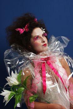 Woman with geisha like make-up and cellophane