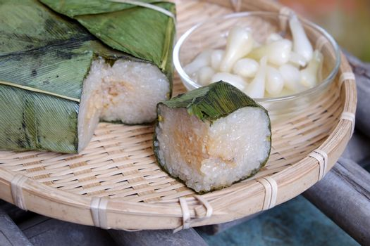 Vietnamese food for Tet holiday in spring, banh chung is traditional food on lunar new year, a rice cake stuffed with pork, green bean, is tradition culture in spring