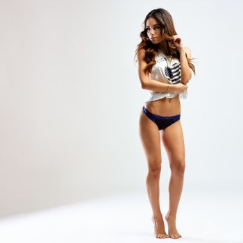 Attractive young woman posing in underwear and t-shirt