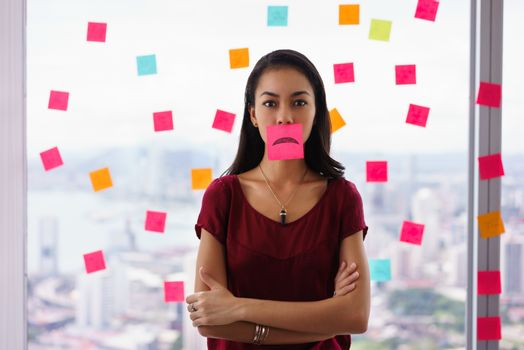 Busy Person Holds Sticky Note On Mouth With Emoticon