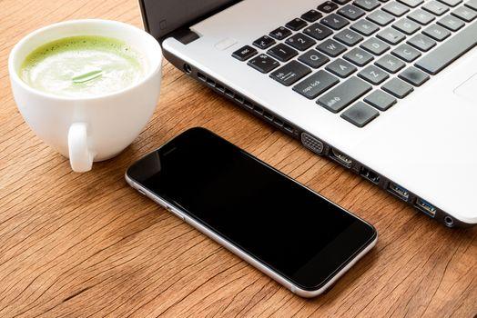 closeup black phone on desk