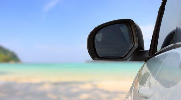 traveling car on bright beach