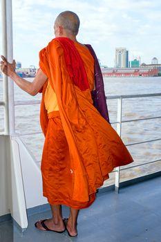 YANGON, MYANMAR - november 24, 2015: Monk on the ferry at Yangon