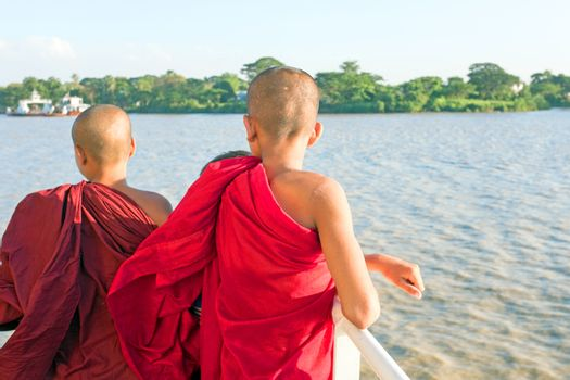 YANGON, MYANMAR - november 24, 2015: Young monks on the ferry at Yangon Myanmar