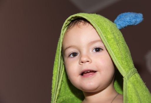 pretty young Boy in towel after bath