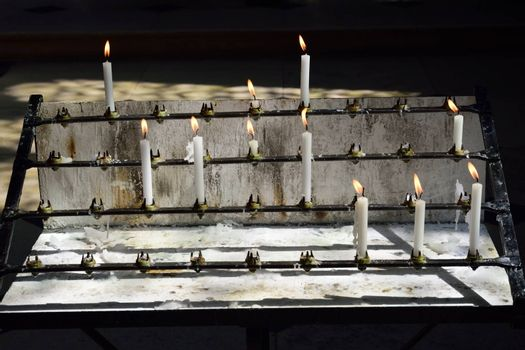 Burning white candles in church