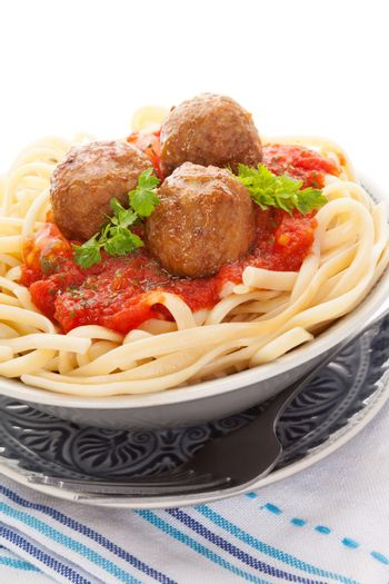 Delicious pasta with tomato sauce and meatballs. Traditional mediterranean eating.