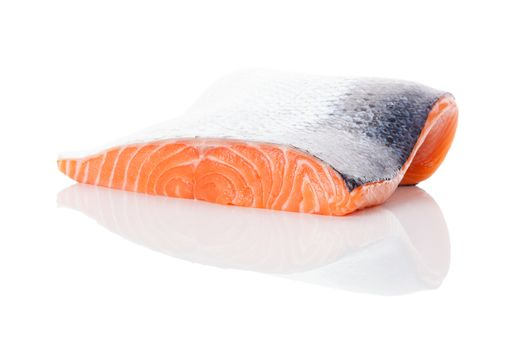 Raw salmon steak isolated on white background. Sashimi sushi. Luxurious healthy seafood eating.