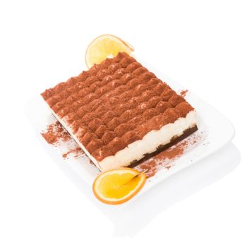 Delicious tiramisu dessert isolated on white background. Culinary traditional sweet dessert.