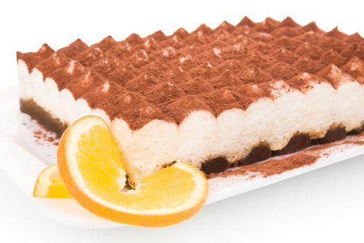 Delicious tiramisu dessert isolated on white background. Culinary traditional sweet dessert.