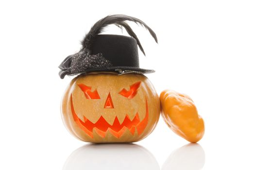 Creepy halloween pumpkin with hat isolated on white background. Traditional american halloween decoration.