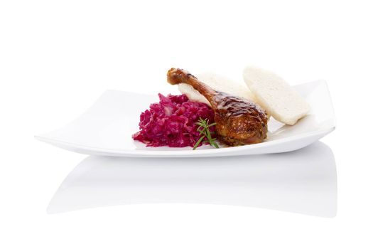 Delicious roast duck with red cabbage and dumplings. Traditional festive eating.
