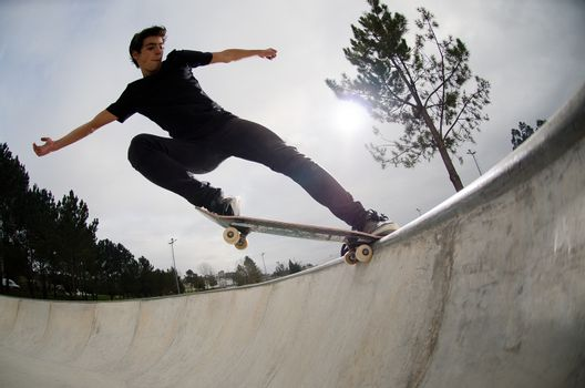 Skateboarder doing a tail slide