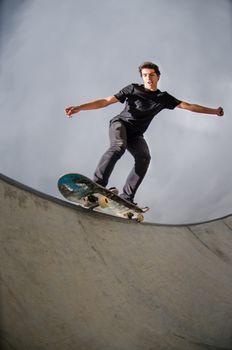 Skateboarder doing a grind