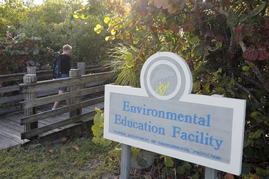 Hollywood, FL, USA - December 20, 2014: Wooden foot bridge to the Environmental Education Facility located at 9899 N Ocean Dr. This center is located at the north end of John U Lloyd Beach State Park.