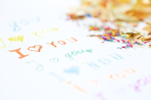 Paper with love you message and colored pencils trash