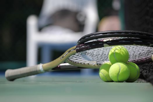 Tennis ball and racket