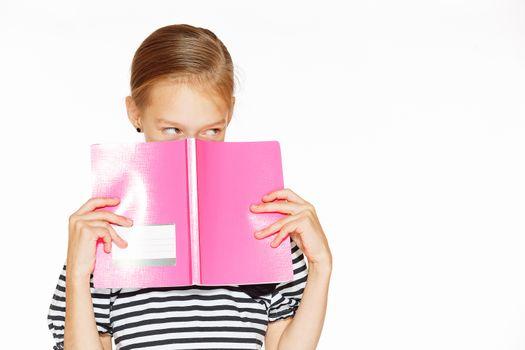 Beautiful girl with copybook
