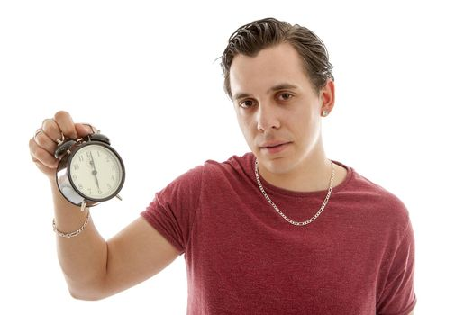 Young man is holding alarm clock at 6 o'clock over white background