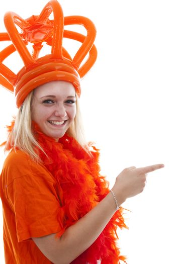 Young woman as Dutch orange supporter is showing something over white background