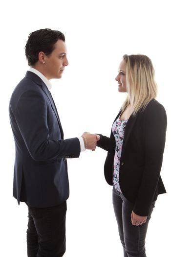 Businessman is shaking young woman hand over white background