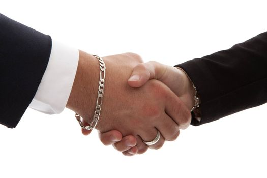 Two persons shaking hands in closeup over white background