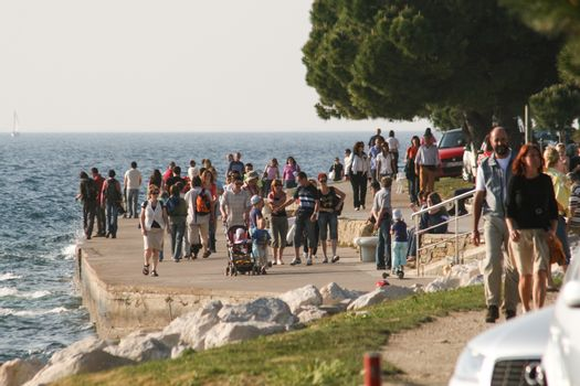 Crowded promenade in Trieste.