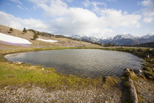 View on a smal lake in Velika Planina plateau in Slovenia