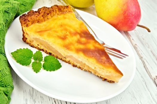 Pie pear with sour cream on board