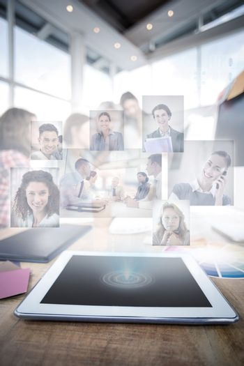 Composite image of business people having a meeting