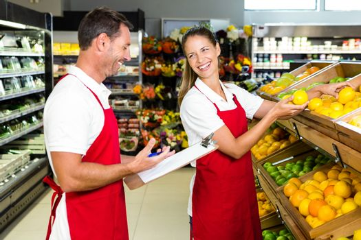 Grocery store staff with clipboard
