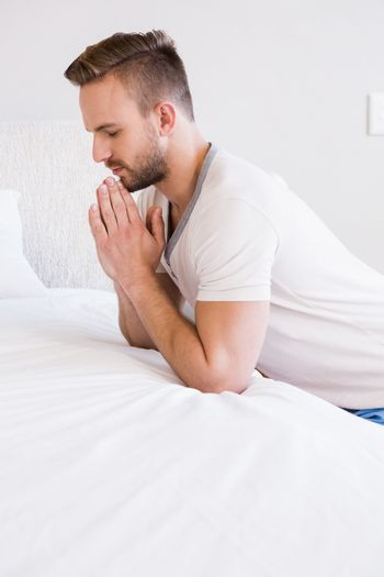 Concentrated man praying