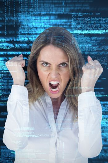 Angry yelling businesswoman against shiny blue coding on black background