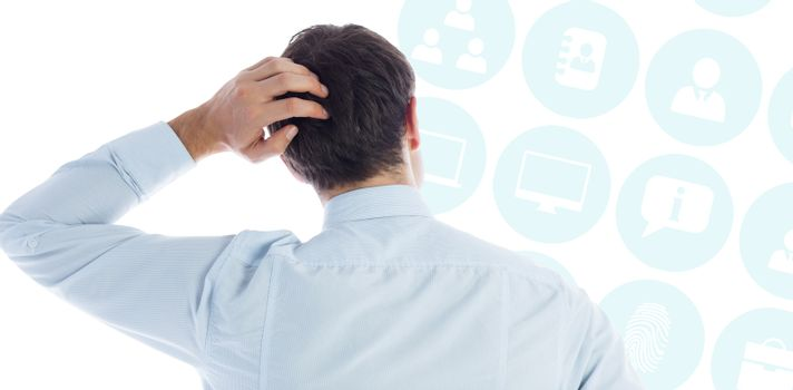 Composite image of businessman scratching his head