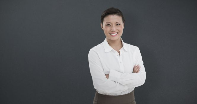 Composite image of portrait of beautiful businesswoman with arms crossed on white background