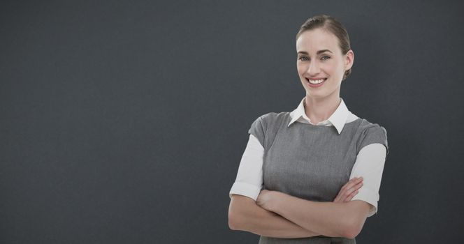 Composite image of portrait of beautiful businesswoman with arms crossed