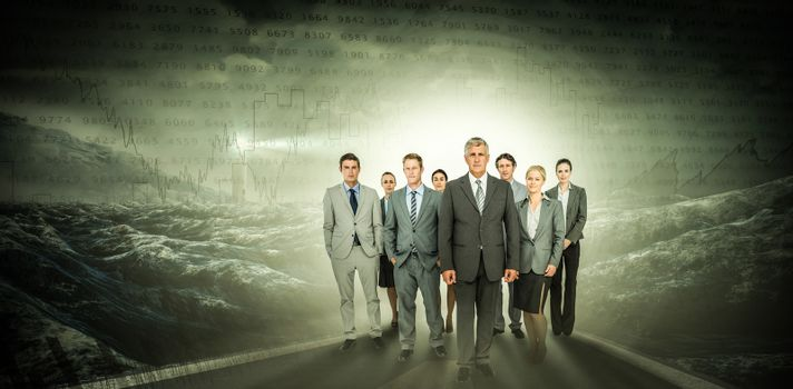 Composite image of smiling business team looking at camera