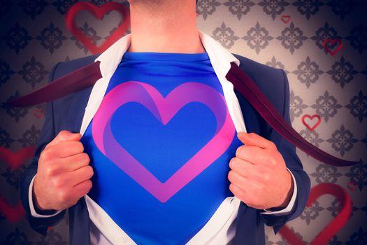 Businessman opening his shirt superhero style against love heart pattern