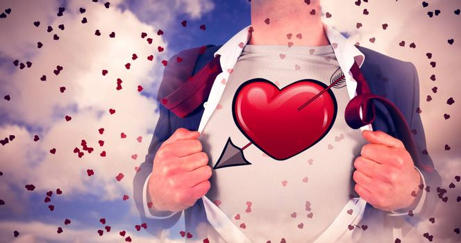Businessman opening shirt in superhero style against blue sky with white clouds