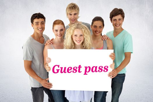 The word guest pass and group of teenagers holding a blank card against white wall